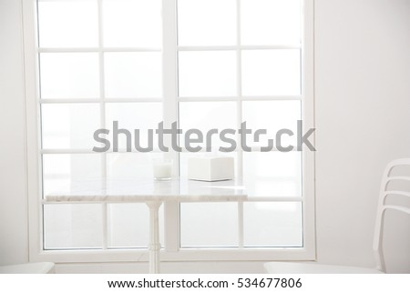 table and chair in white