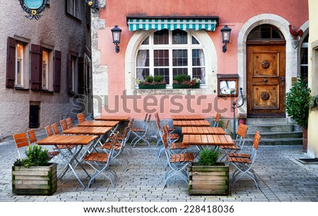 table and chairs at a cafe - beergarden - stock photo