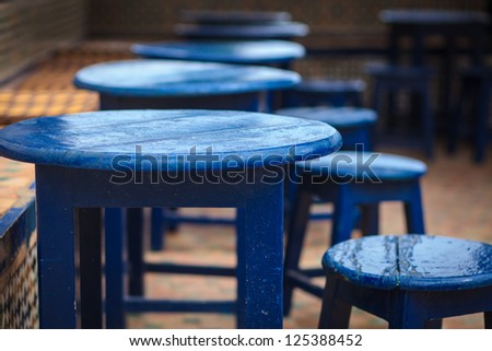 Table and chairs colored in blue - stock photo