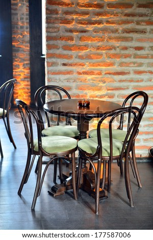table and chairs in a pub bar - stock photo