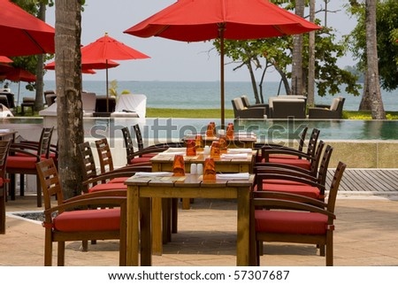 Table and chairs in empty cafe at island Koh Chang , Thailand.