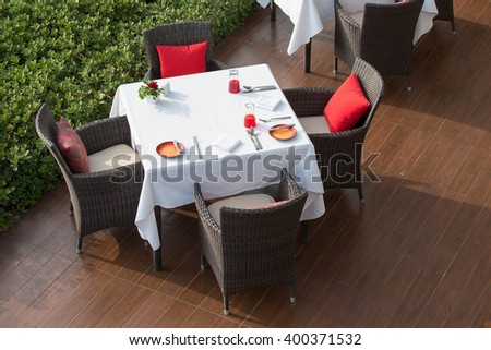 Table and chairs in empty cafe next the beach, top view. Island Koh Samui, Thailand - stock photo