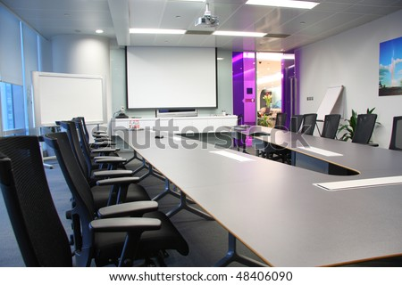 table and chairs in the boardroom - stock photo