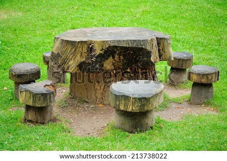 table and chairs made from old stump - stock photo