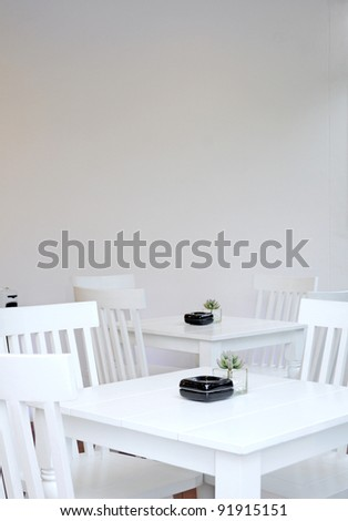 Table and chairs on a white - stock photo
