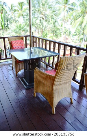 Table and chairs rattan in restaurant indoor. - stock photo