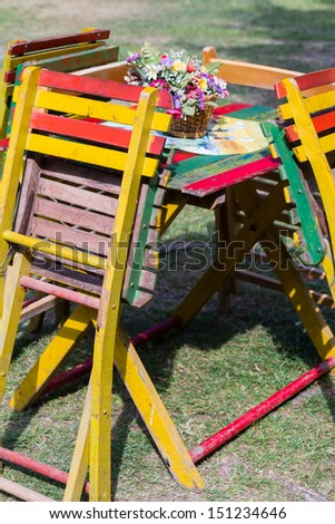 Table and chairs standing at the garden - stock photo