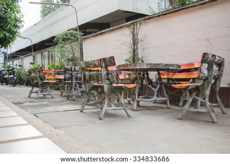 Table and chairs with white wall , cement in-THAILAND