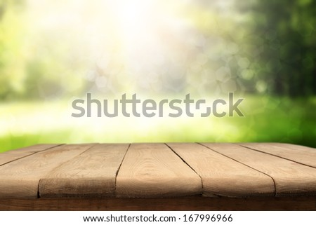 table and garden space with bokeh decoration  - stock photo