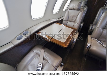 Table and seats inside of small business jet
