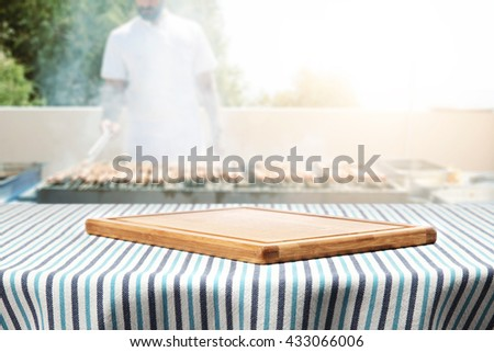 table and tablecloth and summer day and cook