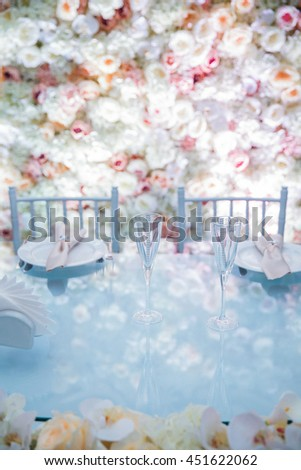 Table appointments in the flowers background - stock photo