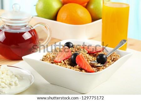 Table Breakfast - Continental Breakfast, fruit, cereals, orange juice and milk - stock photo