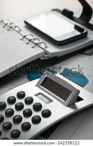 Table businessman with office supplies, as background