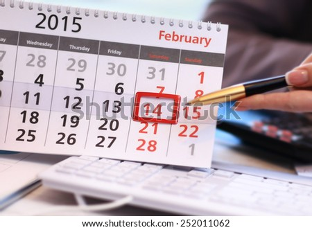 Table calendar with opened page on 14 february - Valendine Day - stock photo