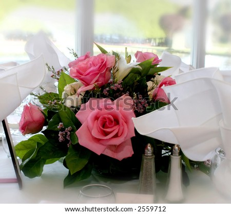table centerpiece made of pink roses - stock photo