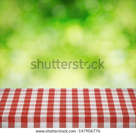 Table cloth and nature background - stock photo
