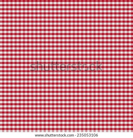 table covered by red checkered tablecloth or gingham cloth - stock photo
