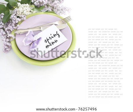 Table decoration with lilac - stock photo