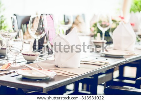 Table dining set in the hotel restaurant - light vintage filter effect processing style pictures - Selective focus point