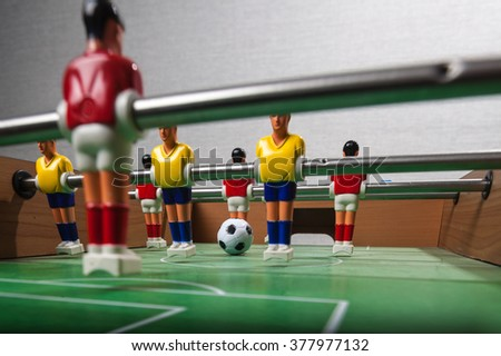 Table football game with a ball. Foosball - stock photo