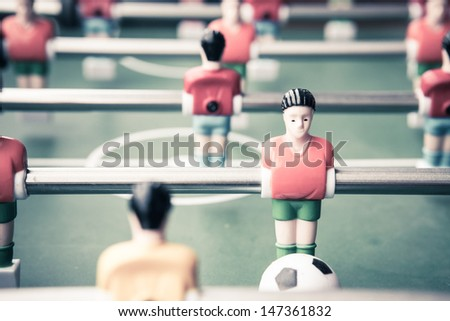 Table football game with red and blue player - stock photo