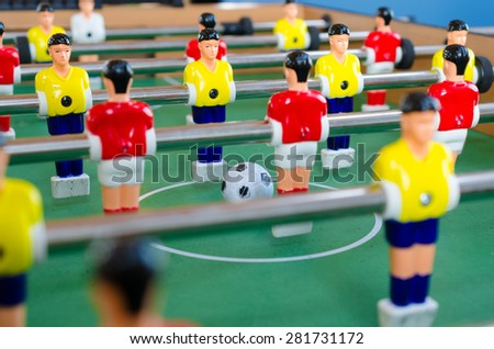 table footTable football game with yellow and red playersball - stock photo