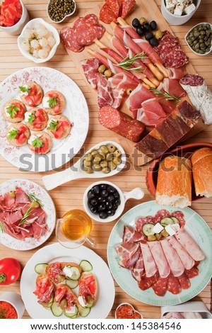 Table full of antipasto or tapas, appetizer food - stock photo