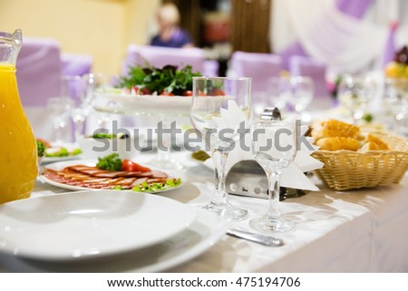 Table in a restaurant with glasses, napkins and cutlery