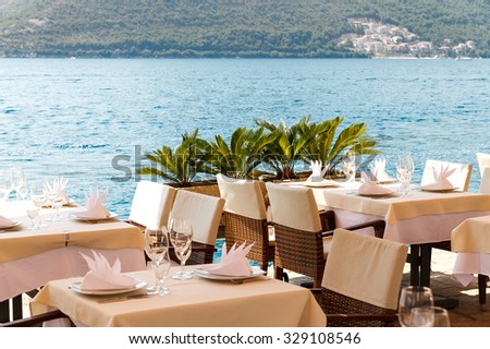 table in the restaurant on the sea background