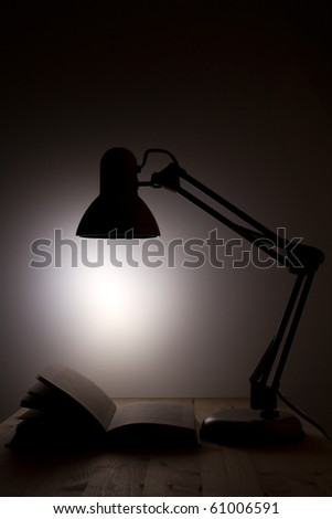 table lamp and book - stock photo