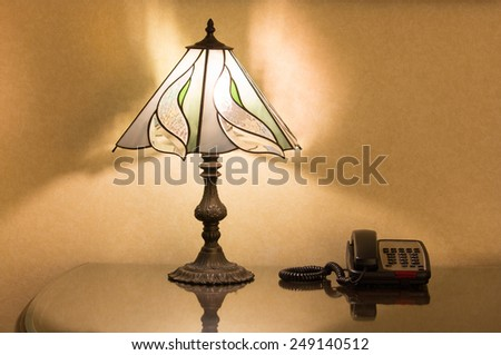 table lamp and phone on desk - stock photo