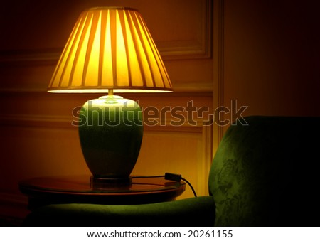 table lamp and sofa with wooden background - stock photo