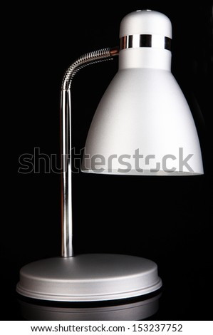 Table lamp on black background - stock photo