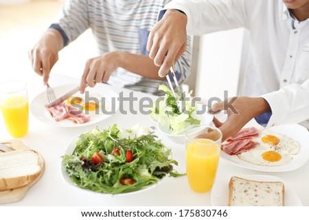 Table landscape of breakfast - stock photo