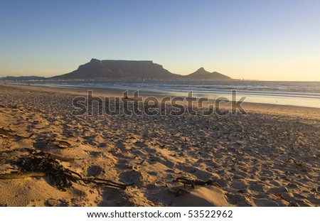 Table mountain at sunset from Blouberg beach - stock photo