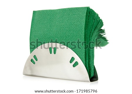 Table napkin holder with green napkins, isolated on white background - stock photo