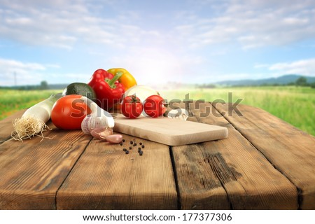 table of vegetables and green grass  - stock photo
