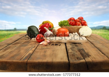 table of vegetables and sunset  - stock photo