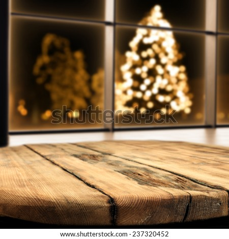 table of wood and xmas tree  - stock photo