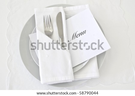 Table place setting in white - stock photo