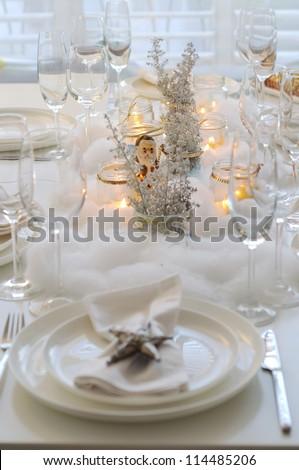 Table prepared for christmas dinner - stock photo