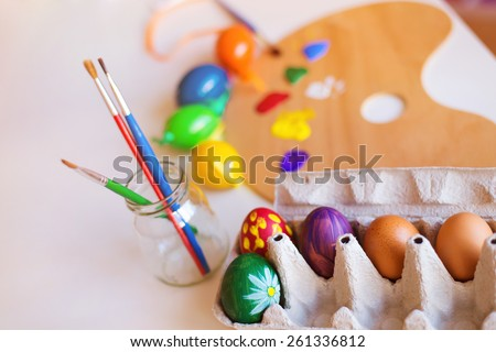 Table prepared for hand painting of easter eggs - stock photo