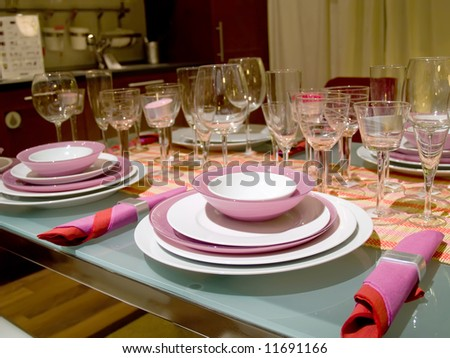 Table served on some persons. Set of glasses. Violet service - stock photo