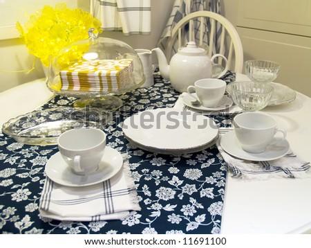 Table served to tea drinking. White tea service - stock photo
