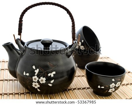 Table serving for chinese tea ceremony at bamboo mat over white - stock photo