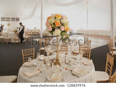 Table set at a luxury wedding reception event party - stock photo