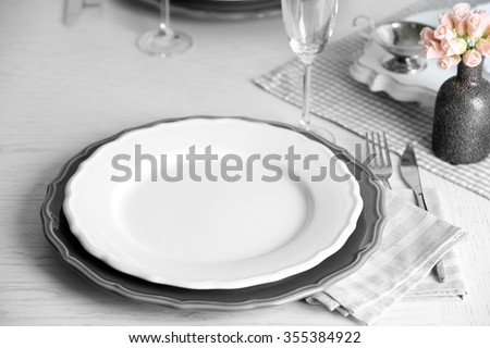 Table set at restaurant on light background - stock photo