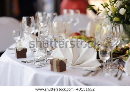 Table set for a festive party or dinner with a brown box - stock photo