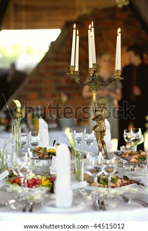 Table set for a festive party or dinner with candles